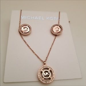 Micheal Kors rose gold necklace and earrings
